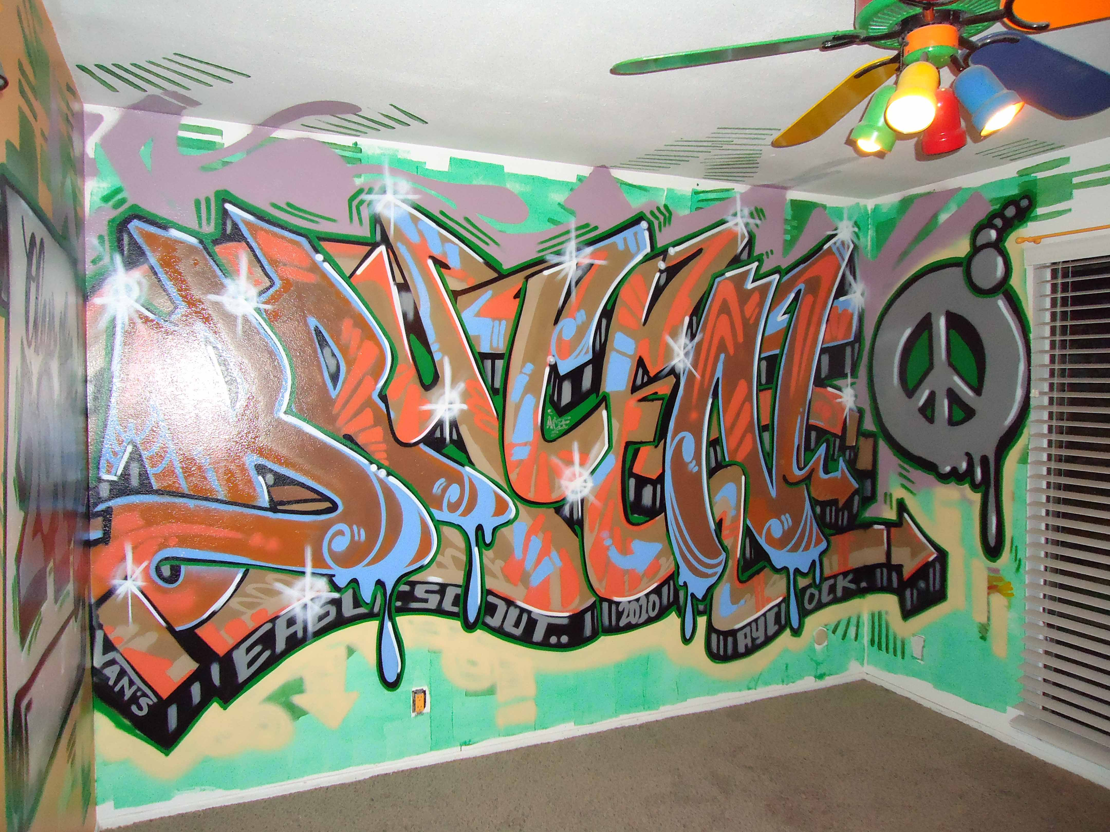 My son is now a teenager and decided he wanted to redecorate his room i hope he likes the graffiti wall i had done for him while hes away at scout camp
